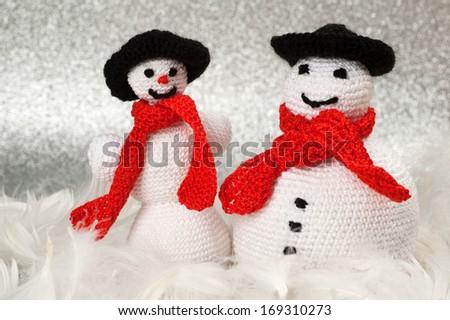 Two Handmade Christmas Crochet Snowmen - stock photo