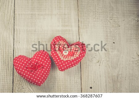 Two Handmade hearts on white wooden background. Vintage soft colours - stock photo