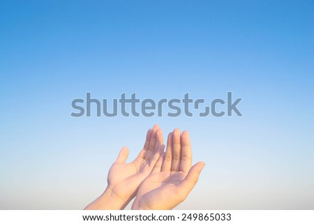 two hands and cross of christ and believers - stock photo
