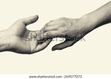 Two hands (farewell touch lovers) - stock photo