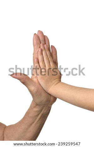 Two hands giving each other a High Five - stock photo