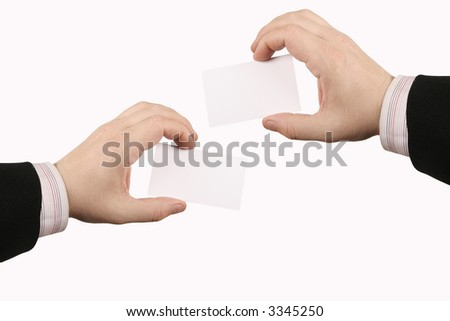 two hands holding a businesscard - stock photo
