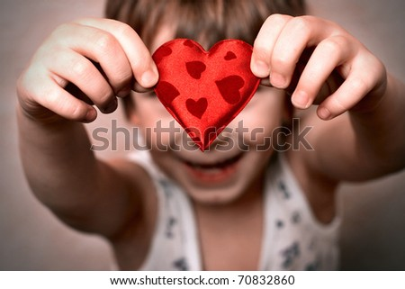 two hands holding a red heart - stock photo