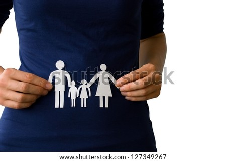two hands holding a white paper chain family - stock photo