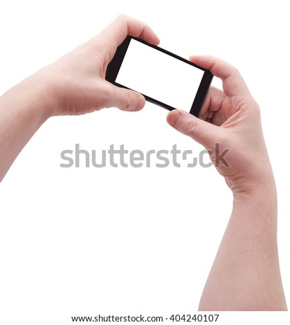 Two hands holding big smart phone, angle view, isolated on white, clipping path - stock photo