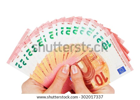 Two hands holding ten euro notes isolated on white - stock photo