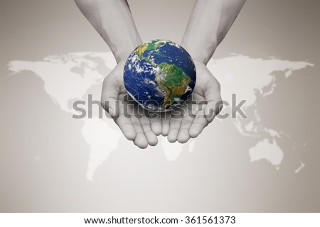 Two hands holding the earth in palm gesture on blurred white map sepia brown color gradient background:world business concept:Elements of this image furnished by NASA.safe and healing world concept.  - stock photo