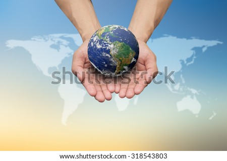 Two hands holding the earth on blurred map over beautiful colorful sky backgrounds.Elements of this image furnished by NASA.safe and healing world concept.education concept.international day of peace. - stock photo