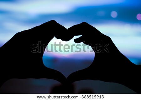 Two hands make heart shadow - stock photo