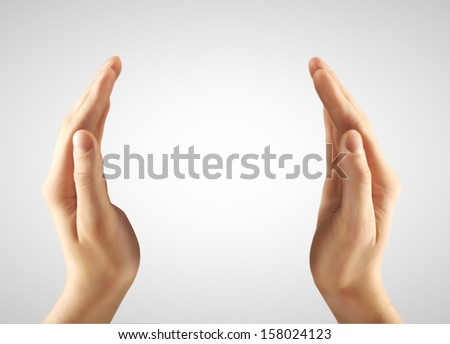 two hands  on a gray background - stock photo