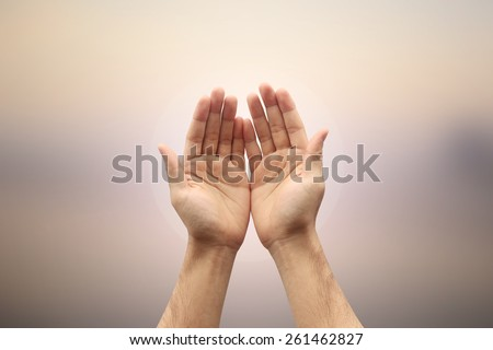 Two hands open palm gesture showing on blurred nature backgrounds,soft focused - stock photo