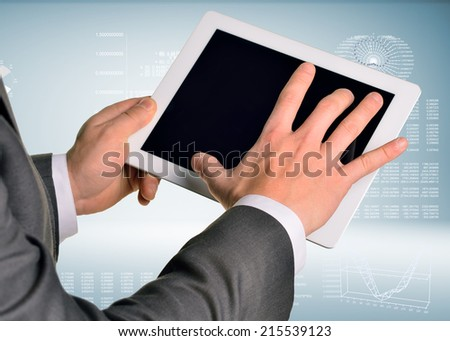 Two hands using tablet pc - stock photo