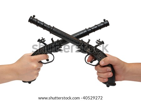 Two hands with an old pistol, 19 century. Isolated on white, with clipping path. - stock photo