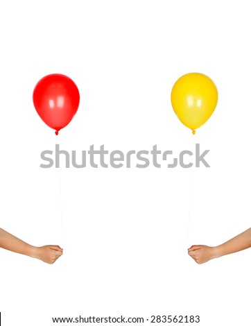 Two hands with color balloons isolated on a white background - stock photo
