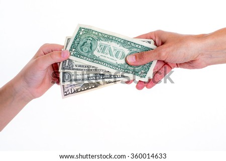 two hands with money in front of white background - stock photo