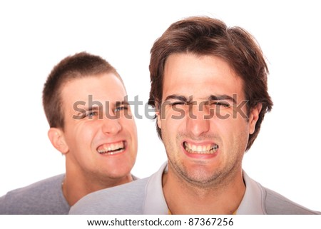 Two handsome men posing over white background - stock photo