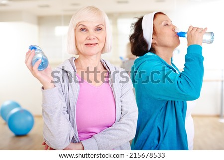 Two happy aged women after workout - stock photo