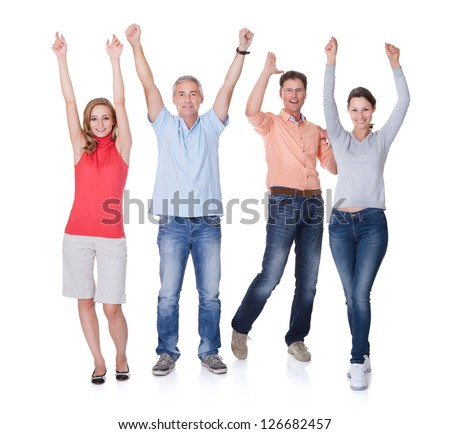 Two happy attractive couples in casual clothes and jeans celebrating raising their arms in the air and shouting on white - stock photo