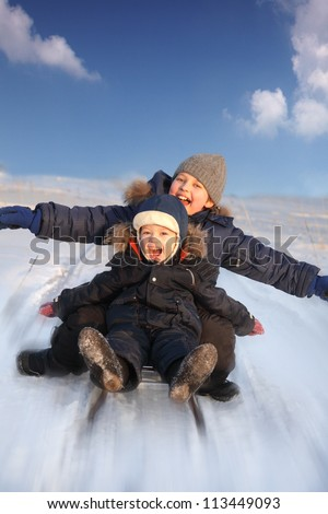 two happy boys on sled - stock photo