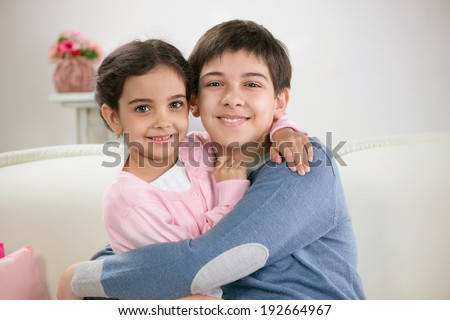 Two happy brother and sister having fun together - stock photo