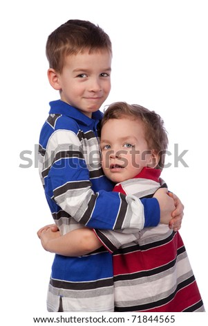 Two happy brothers hugging, isolation - stock photo