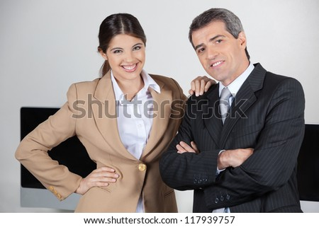 Two happy businesspeople together in the office - stock photo