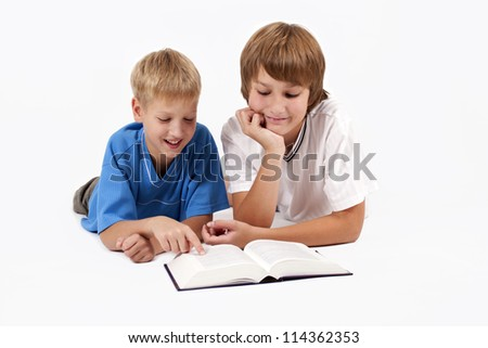 Two happy children with the book - stock photo