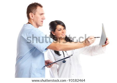 Two happy doctors having medical consultation of x-ray image - stock photo