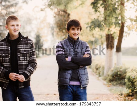 Two happy friends in park - stock photo