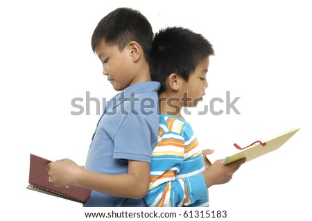 Two happy friends standing reading a book. - stock photo