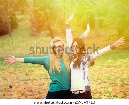 Two happy girl friends in nature - stock photo