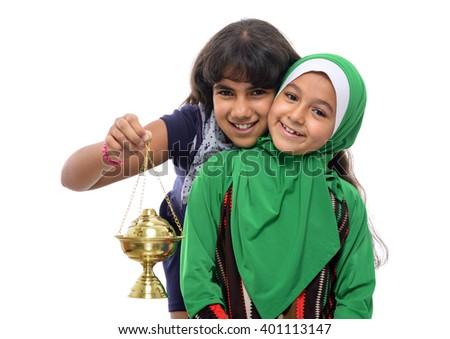 Two Happy Girls Celebrating Ramadan Isolated on White Background - stock photo