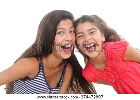 two happy girls on a white background - stock photo