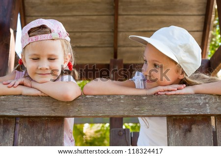 two happy  girls  on the playground - stock photo
