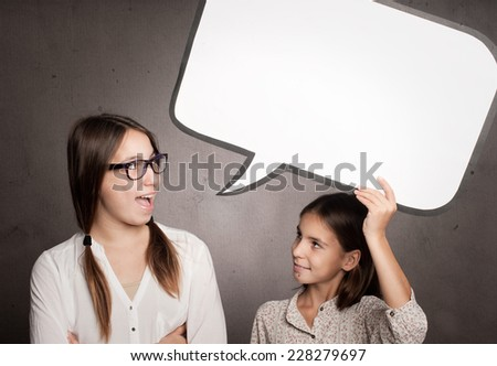 two happy girls with a speech bubble - stock photo
