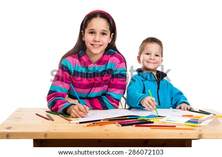 two happy kids learn to draw together, isolated on white - stock photo
