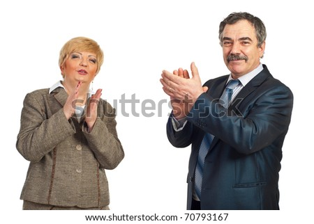 Two happy mature business people applauding isolated on white background - stock photo