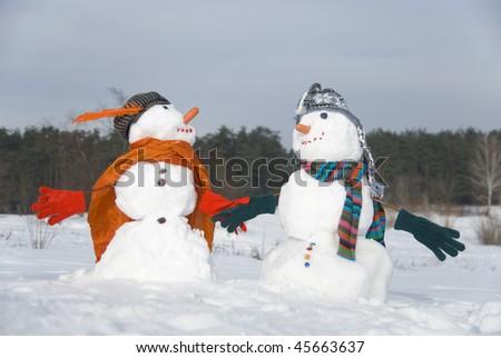 Two happy snowmen - stock photo