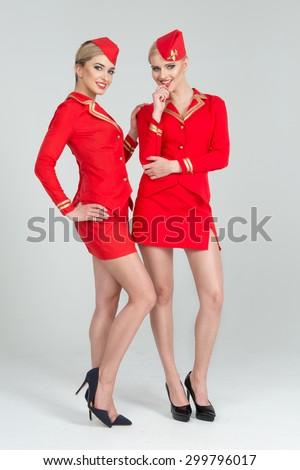 Two happy stewardesses - stock photo