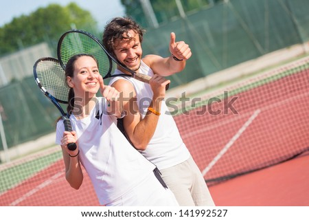 Two Happy Tennis Players with Thumbs Up - stock photo