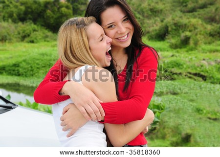 two happy women on car trip - stock photo