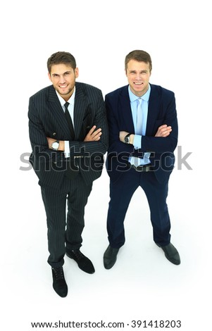 Two happy young businessmen full body, isolated on white - stock photo
