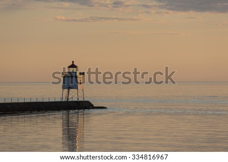 Two Harbors Pier Lighthouse After Sunset - stock photo