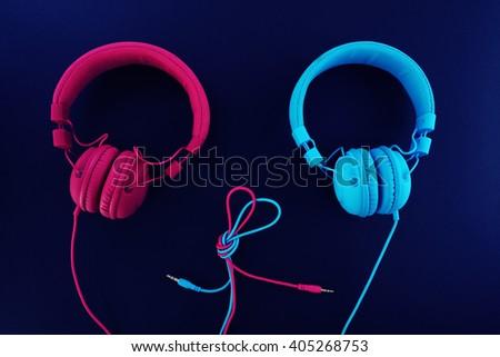 Two headphones - one heart.  - stock photo
