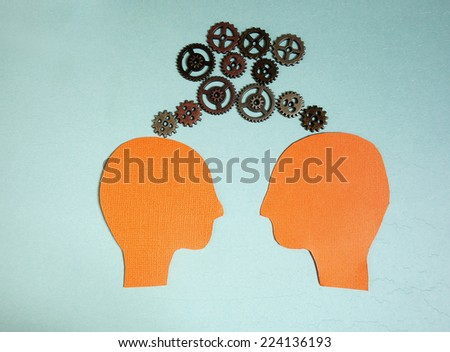 Two heads with gears - teamwork concept                              - stock photo