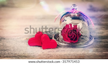 Two Hearts and a Rose - stock photo