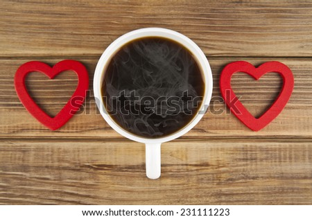 two hearts and coffee on a wooden background - stock photo