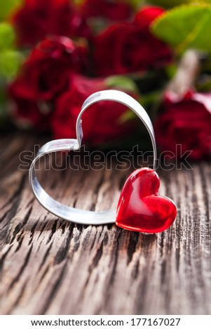 two hearts and roses on wood - stock photo