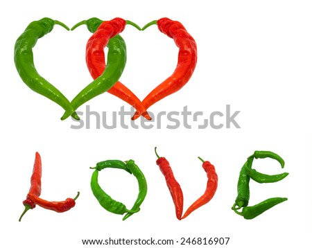 Two hearts and word Love composed of green and red chili peppers. Isolated on white background. - stock photo