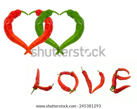 Two hearts and word Love composed of red and green chili peppers. Isolated on white background. - stock photo